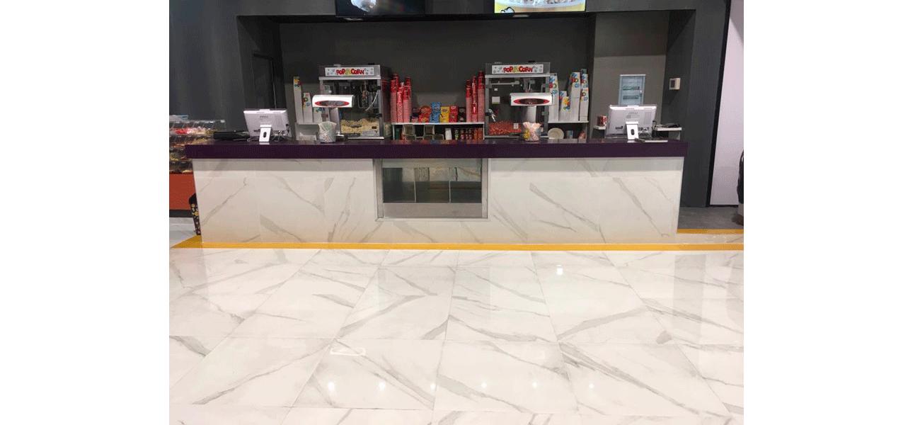 pavimento cines axion 2